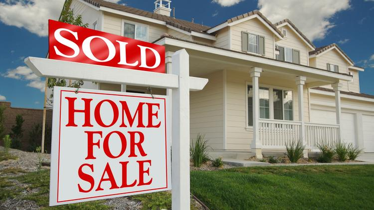 Home prices are up over last year, but the number of sales is down.