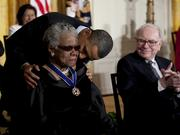 Warren Buffett, chairman and chief executive officer of Berkshire Hathaway Inc., right, looks on as President Barack Obama awards author, poet, and civil rights activist Maya Angelou the Presidential Medal of Freedom at the White House in Washington, D.C.,  in 2011. Angelou has died at age 86.