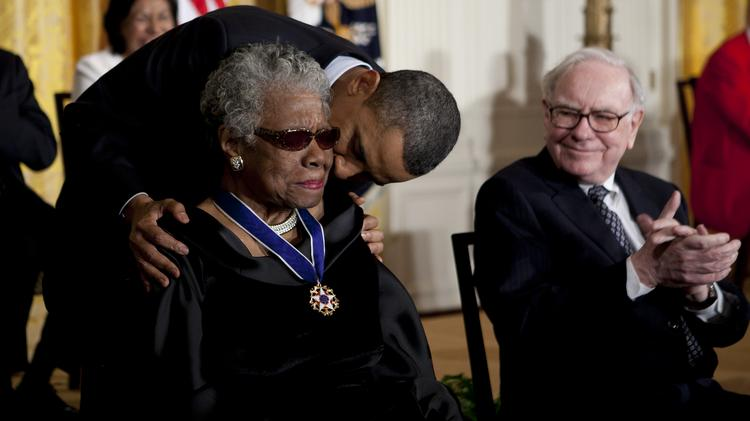 Warren Buffett, chairman and chief executive of Berkshire Hathaway Inc., right, looks on as President Barack Obama awards author, poet and civil rights activist Maya Angelou the Presidential Medal of Freedom at the White House in  2011. Angelou has died at age 86.