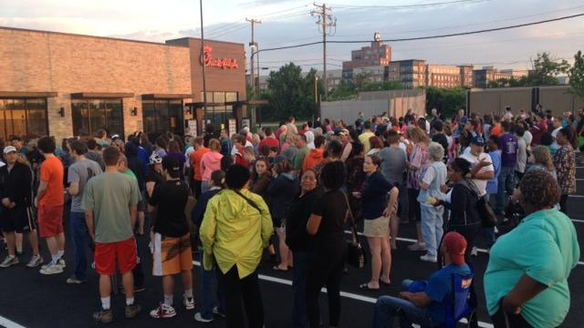 A crowd gathers outside the Canton Chick-fil-A on Wednesday morning.