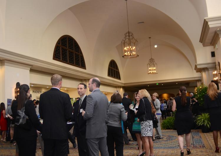 Guests mingle at the networking event before the 2013 Women Who Mean Business awards dinner at Rosen Shingle Creek.