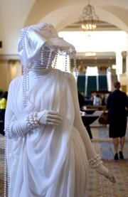 A living statue provides unique decor for the networking event before the awards dinner.