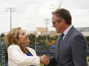 AARP Foundation President Lisa Marsh Ryerson and Dolphins President and CEO Tom Garfinkel
