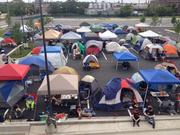 Some 100 people have set up tents outside the Chick-Fil-A in Canton. The restaurant, set to open Thursday, will give free meals for a year to the first 100 people in line.