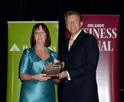 2013 Business Executive honoree Kathleen Canning receives her award.