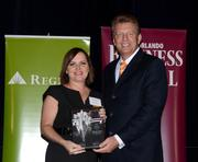 2013 Business Owner honoree Wendy Connor receives her award.