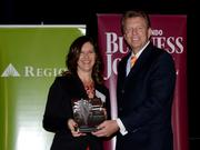 2013 Business Owner honoree Angela Highland receives her award.