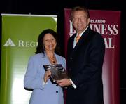 2013 Business Owner honoree Diana LaRue receives her award.