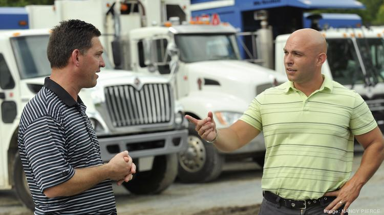 God Bless the USA Inc. Chief Executive Jason Horner, right, speaks to company President Erik Blowers at the company's facility in Union County.