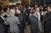 Attendees enjoy some high-level networking at the 2013 Business of the Year Awards held at the International Game Fish Association Hall of Fame and Museum.