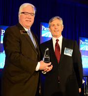 Tim Lee, chairman of Cobb County Board of Commissioners, presents the Pacesetter Award to Greg Goldenberg, CEO of Acadia Home & Neighborhoods.
