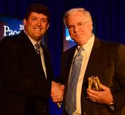 Dan Campbell, CEO of Hire Dynamics, presents a Pacesetter Award to David Northington, CEO of Cloud Sherpas.