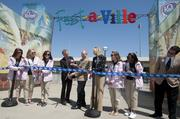 Louisville Mayor Greg Fischer and other dignitaries cut the ribbon officially opening Fest-a-Ville.