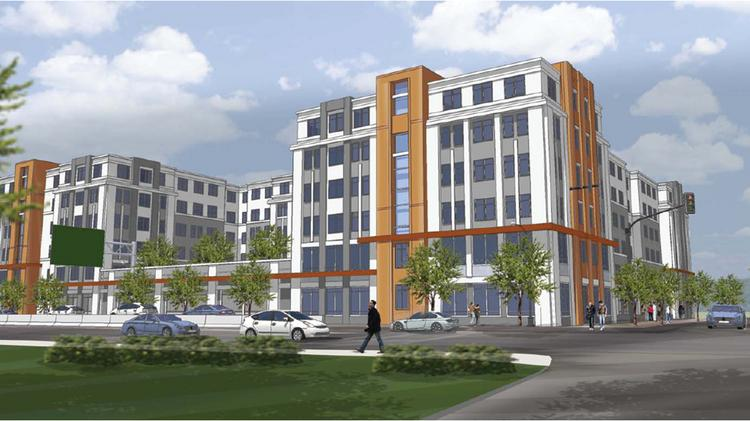 An artist rendering of an apartment complex under construction across from the Quincy Adams MBTA Station.