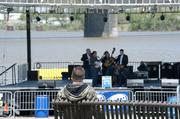 A fan watched a bluegrass group play at the opening of the Chow Wagon.