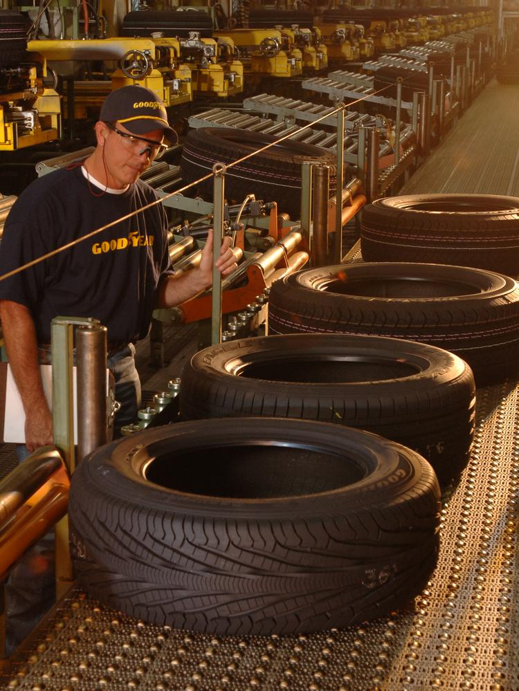 A worker in a Goodyear plant in Lawton, Okla., watches over Goodyear Assurance TripleTred tires.