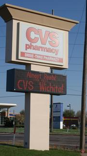 The sign at the new CVS store on 13th and Maize announces the opening Sunday of Wichita's first CVS store. Two more open in July and a fourth in early 2014.