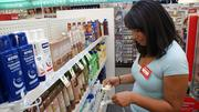 Customer service representative Ciera Clark tags items with special prices in advance of Sunday's opening.