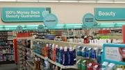 """Large wall signs make it easy to find the category you're looking for, with smaller """"lollipop signs"""" on shelves offering specific products in that category. Signs are color-coded."""