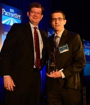 David Evans, managing partner at Dixon Hughes, Goodman presented the Pacesetter Award to Victor Cooper from Airwatch.