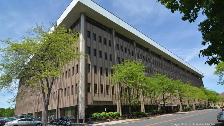 The headquarters of the New York State Department of Transportation will be merged with the state Thruway Authority in Albany, a move that will put this state-owned office building up for sale on bustling Wolf Road in Colonie.