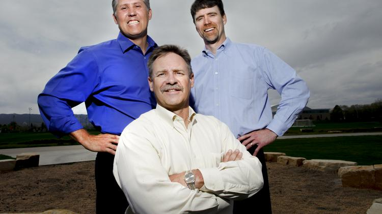 Randy DeMario (left), president of Heath Construction Co., Greg Schmidt (right), president of Saunders Construction Inc., and John Beeble (center), chairman and CEO of Saunders Construction, on the Colorado State University campus in Fort Collins.