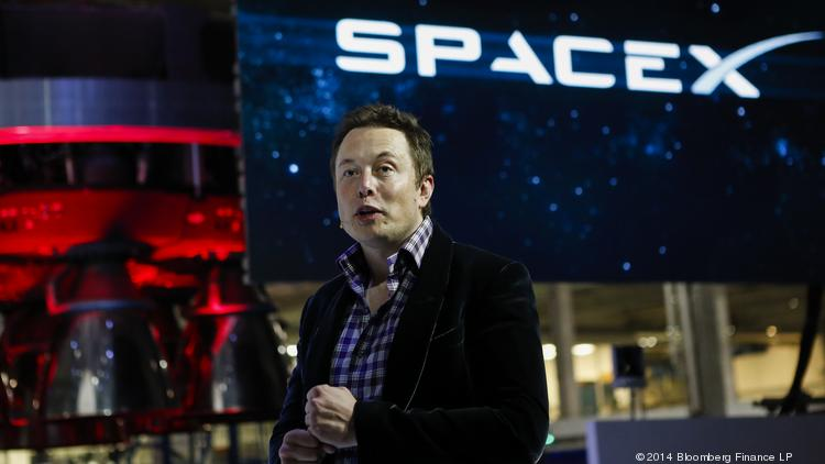 Elon Musk, chief executive officer of Space Exploration Technologies Corp. (SpaceX), speaks at the unveiling of the Manned Dragon V2 Space Taxi in Hawthorne, Calif., on May 29, 2014.