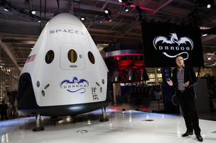 Elon Musk, chief executive officer of Space Exploration Technologies Corp. (SpaceX), speaks at the unveiling of the Manned Dragon V2 Space Taxi in Hawthorne, California, on  May 29, 2014. The Dragon V2 is a manned space taxi, an upgraded version of the unmanned spacecraft Dragon, that will be capable of sending a mix of cargo and up to seven crew members to the International Space Station.