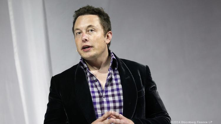 Elon Musk, chief executive officer of Space Exploration Technologies Corp. (SpaceX), speaks before the unveiling of the Manned Dragon V2 Space Taxi in Hawthorne, California, U.S., on Thursday, May 29, 2014.