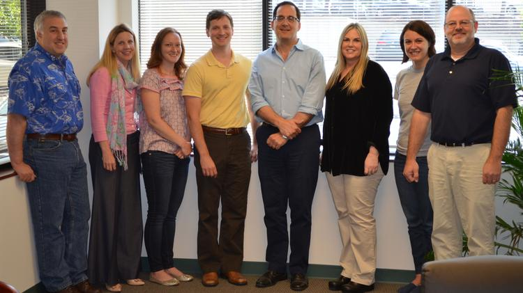 Dr. Mark Velleca (center in blue shirt) and the G1 Therapeutics team