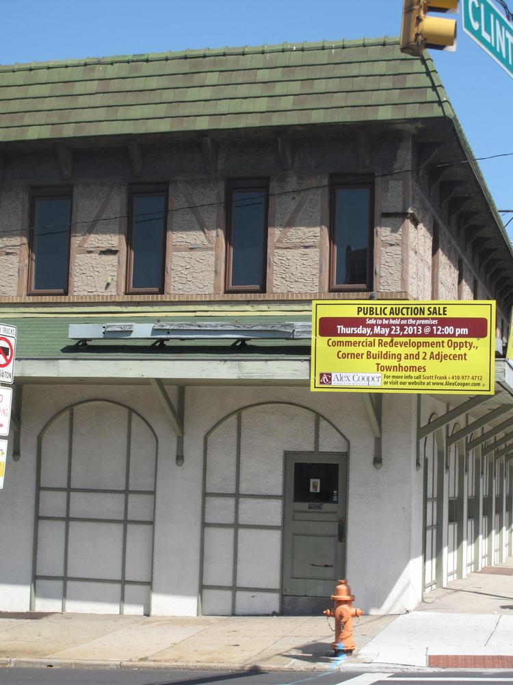 A sign announcing the auction of the Haussner's building is displayed on the front of the former restaurant along Eastern Avenue in Highlandtown.