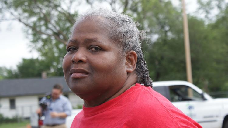 "Janet Wilson, president of the A. Price Woodard Neighborhood Association, calls Habitat's revitalization efforts a ""dream come true"" for her neighborhood. She spoke to reporters following Habitat's news conference Friday."