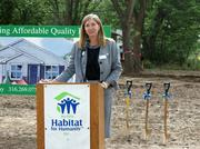 "Ann Fox, executive director of Wichita Habitat for Humanity, speaks during a news conference Friday to kick off the organization's ""Rock the Block"" initiative, which will bring new homes to an area on North Poplar. Five homes will be built in phase one of the project."
