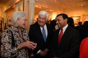 From left, Foundation Fighting Blindness co-founder Lulie Gund, Tom Korologos of DLA Piper and Dinesh Paliwal of Harmon International.