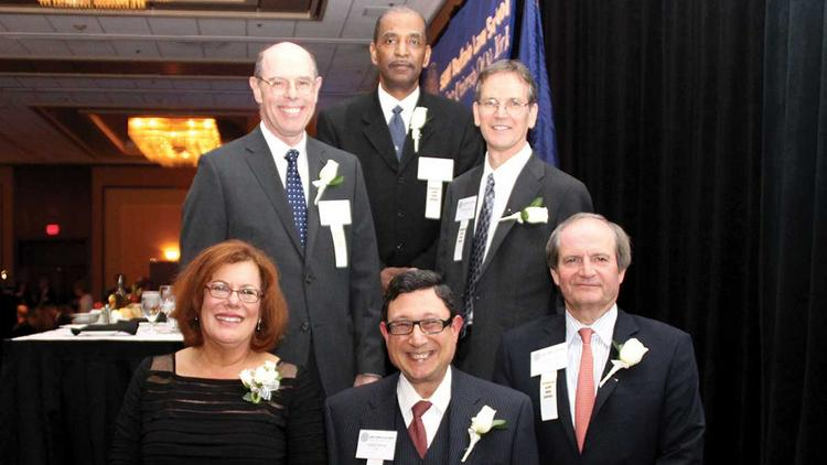 Legal professionals were honored during an awards ceremony at the Law Alumni Association's annual dinner May 20 at the Hyatt Regency Buffalo. Bottom row, from left, Judge Lisa Bloch Rodwin ('85), William Savino ('75) and Robert Schwenkel ('82). Middle row, from left, Judge Eugene Fahey ('84) and Department of Justice attorney Michael Surgalla ('82). At top is Judge Robert Russell, a non-alumnus who was recognized for his work in the judiciary.