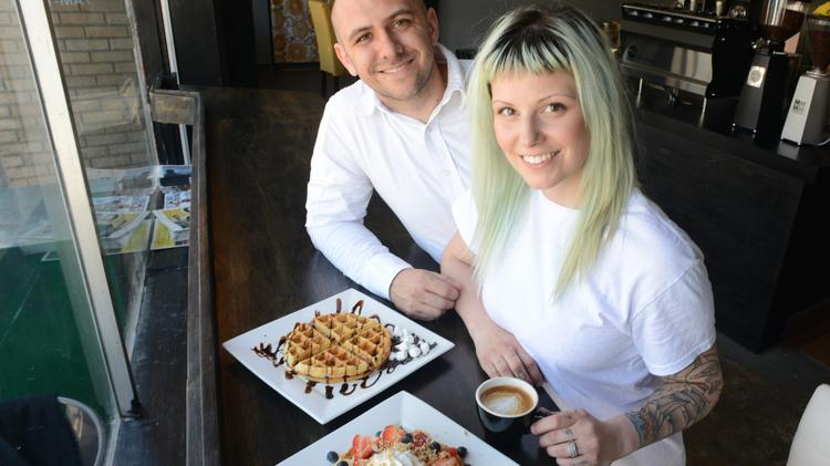 Andrew Ply, left, and Lisa Ply, right, together own half of Black Coffee and Waffle Bar and are in charge of operations.