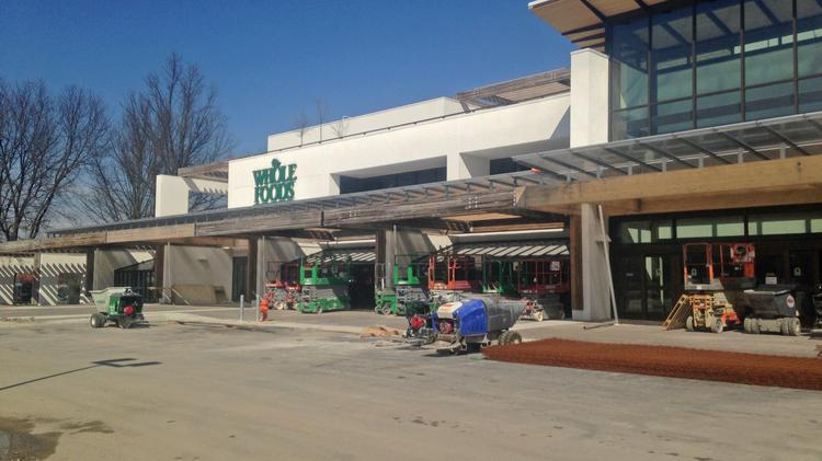 Howard Hughes Corp. is seeking buyers for the former Rouse Co. headquarters in Columbia where a Whole Foods store is under construction.