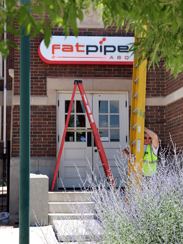 Zeon Signs journeyman sign installer David Foster packs up after installing the new FatPipe ABQ sign.