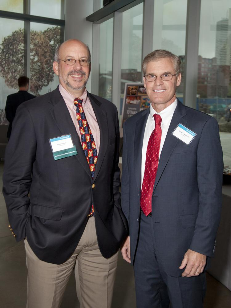 Steven Bauer and Joseph Capraro, two of the original partners in the Boston office of Proskauer Rose, celebrate during a recent even marking the office's 10th anniversary of opening in Boston.