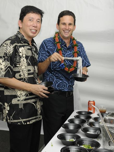 Chef Chai Carowaosaree, left, and U.S. Sen. Brian Schatz, then lieutenant governor, are seen helping to serve spicy oxtail soup with Bihoon noodle at the Signature Chefs Food Festival hosted by the Honolulu Firefighters Foundation, in this October 2012 file photo.