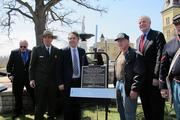 Michael Reynolds, Midwest Region director of the National Park Service (left), Ald. Michael Murphy and Mayor Tom Barrett pose by the plaque with a local veteran.