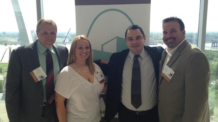 From left, Joseph Spiess, Lindsey Silva, Marcos Silva and Thomas Sawyer of Blue Line Security Systems.