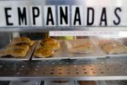 Cooked empanadas sit on display at a restaurant on Calle 8, or Eighth Street, in the Little Havana district of Miami.