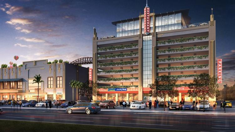 Developer Wallack Holdings LLC has added a new feature atop its $20 million, seven-story public parking garage on International Drive — a glass-enclosed eatery space.