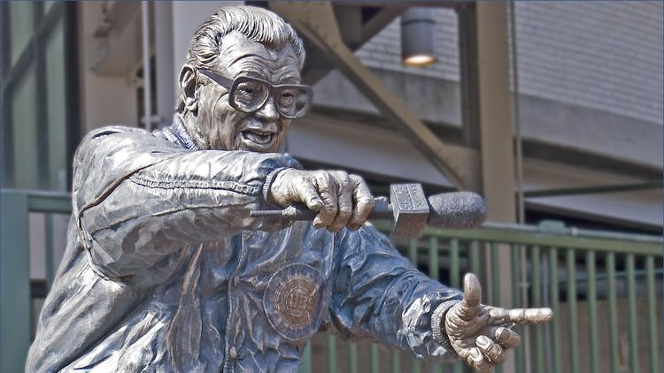 A statue of broadcaster Harry Caray stands outside Wrigley Field.