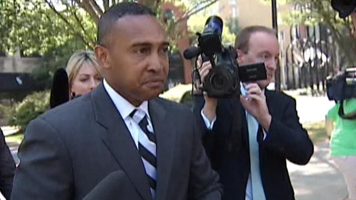 Patrick Cannon, the former mayor of Charlotte, is surrounded by reporters outside the federal courthouse uptown.