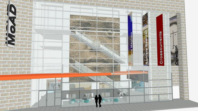 The façade of the musuem showing the entrance and banners, following a redesign by the Gensler architecture firm.