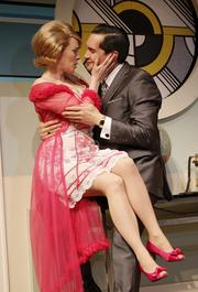 """Left to right: Bhama Roget and Richard Nguyen Sloniker in """"Boeing Boeing"""" at the Seattle Rep through May 19."""