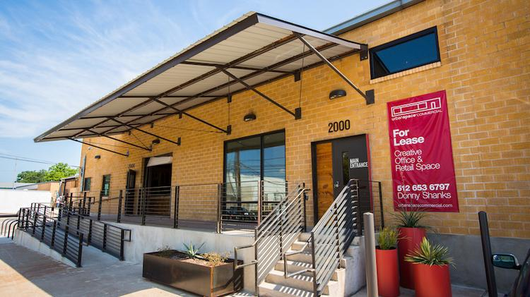 The exterior of 2000 E. Sixth St. has been renovated in a modern, yet still industrial, style.