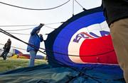 The crew of the ReMax balloon prepared for Friday morning's rush-hour race.